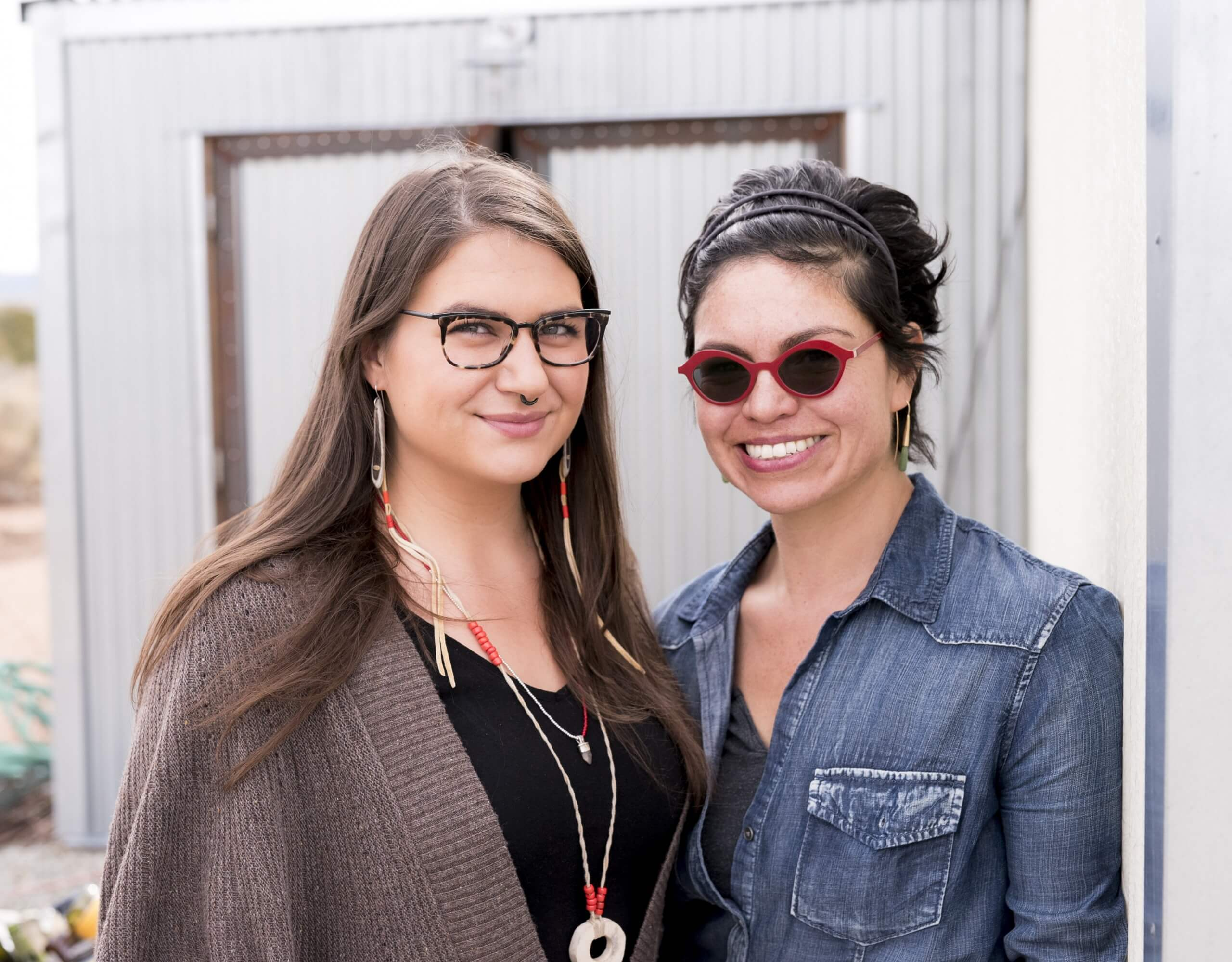 Keri Ataumbi (Kiowa) and Tania Larsson (Gwich'in) outside the studio