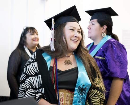 IAIA Alumnae Patricia Michaels (Taos Pueblo, '89), Melissa Shaginoff (Chickaloon/Pyramid Lake, '16), and Jennifer Juan (Tohono O'ogham,'16) during the 2016 IAIA Commencement.