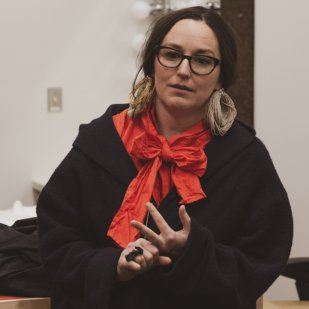 Meghann O'Brien giving a talk in her studio at the Welcome Dinner and Studio Tours on April 12, 2018, photograph by Neebinnaukzhik Southall