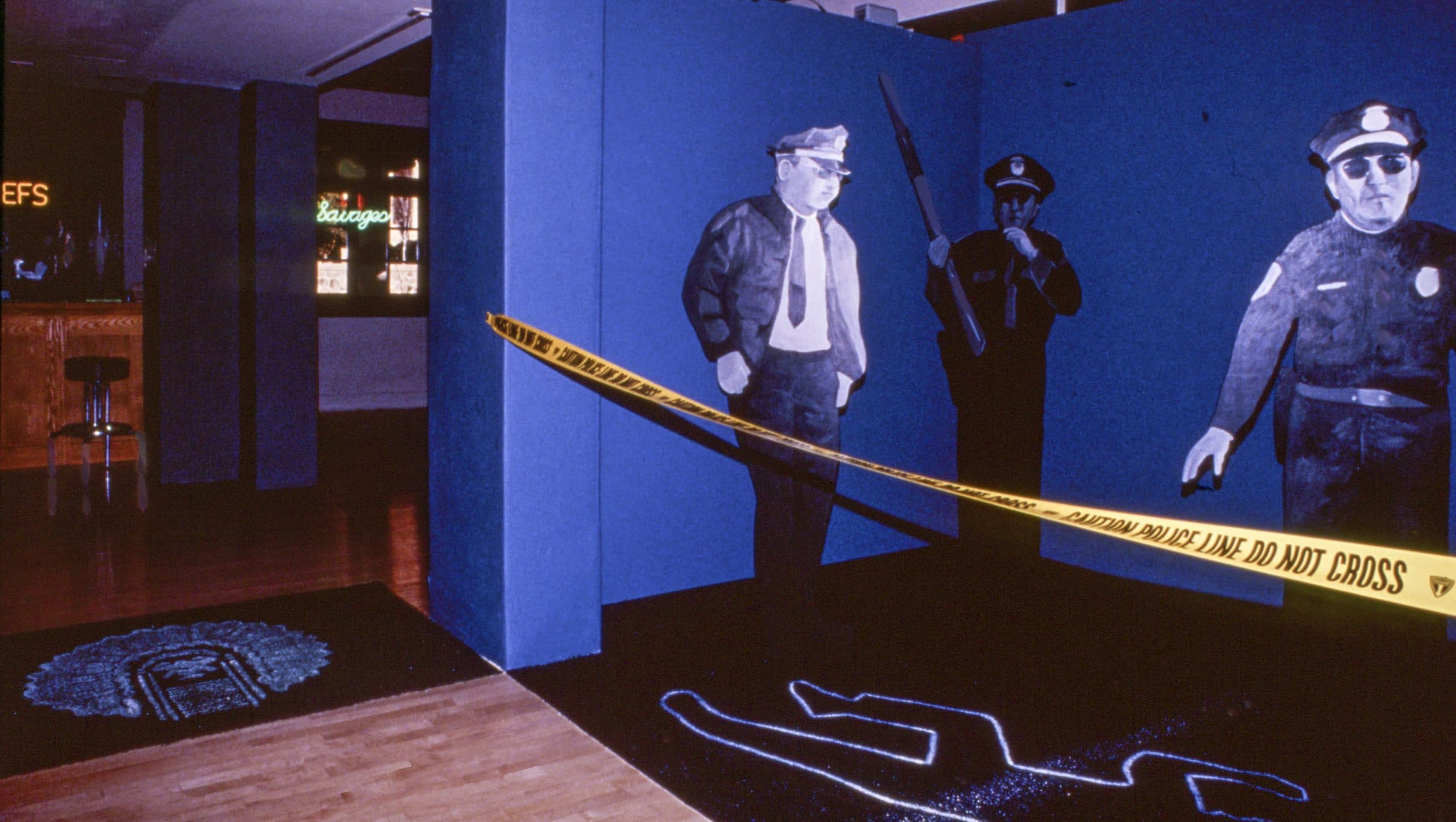 It Was Only An Indian installation detail (1994) by Charlene Teters, mixed media, cutout figures, chalk outline of body; bar w/related material; neon lights, 168 in. w x 360 in., museum collection: Spk-50